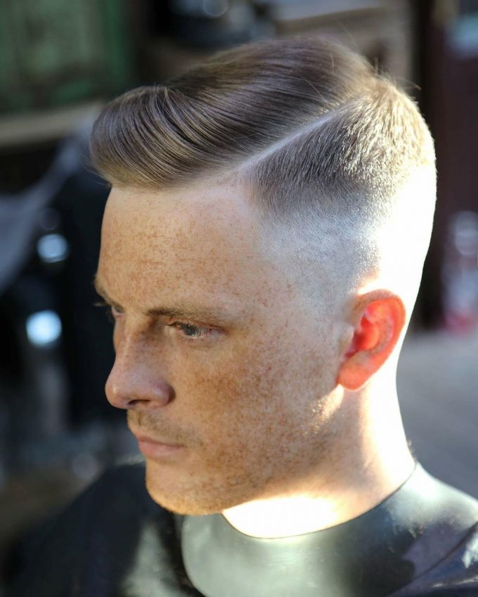 High fade with side parted quiff